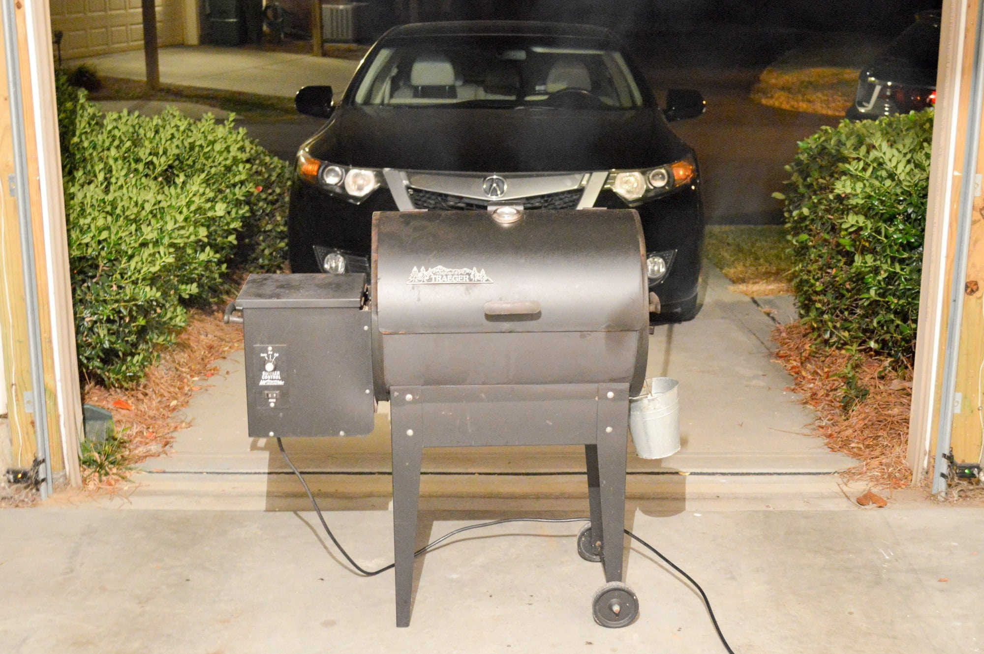 My Treager electric smoker hard at work cooking a family dinner.