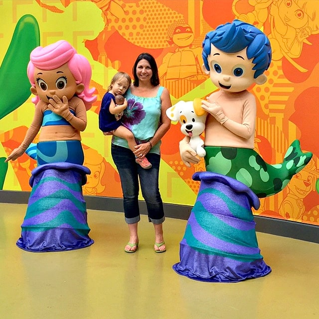 The Unofficial Guide to Mall of America's author, Beth Blair, with her youngest daughter posing with Nick characters in Nickelodeon Universe