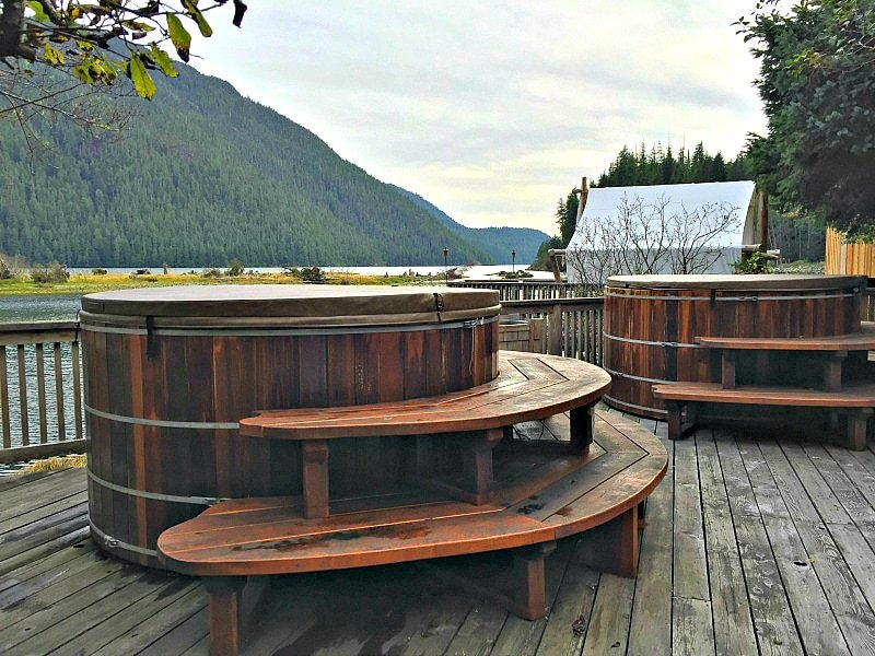 Soak in one of two wooden hot tubs with a view of Bedwell Sound at Clayoquot Wilderness Resort