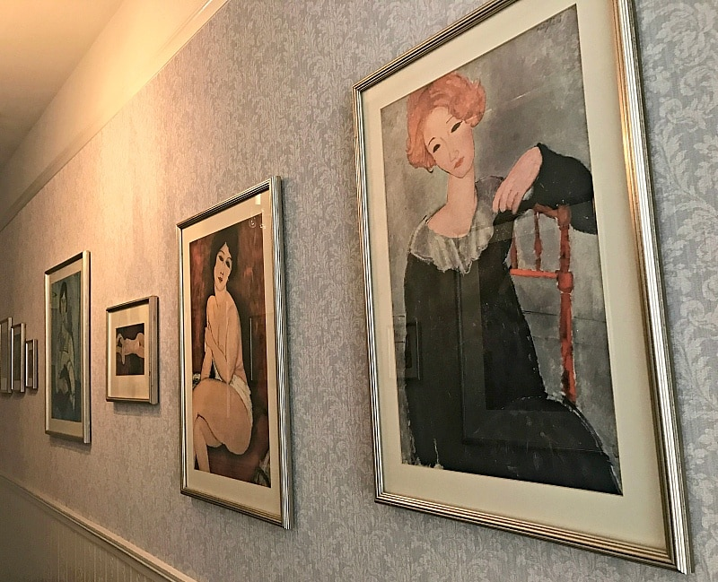 Prints by Amedeo Madigliani adorn the walls of one floor of Cornell Hotel de France