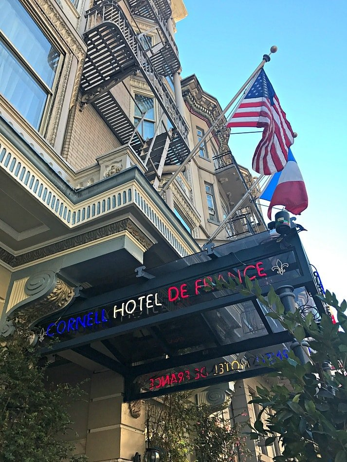 American and French flags welcome guests to Cornell Hotel de France in San Francisco