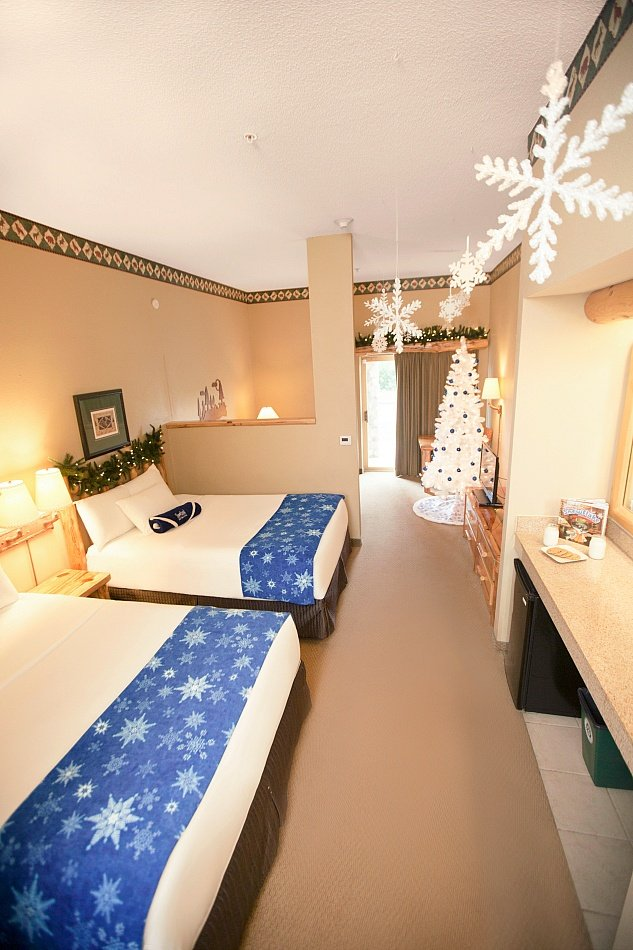Upgrade to a Great Wolf Lodge suite all decked out for the holidays with a full-sized tree and more