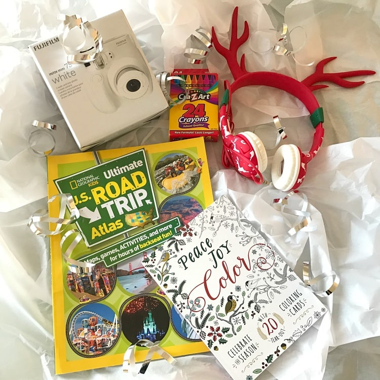 Give an early holiday gift pack filled with things to entertain the kids on the road ~ Holiday Road Trip Tips for a Festive and Safe Journey