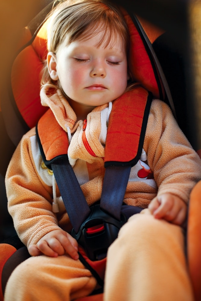 There is nothing better than a sleeping child on a family road trip! ~ Holiday Road Trip Tips for a Festive and Safe Journey
