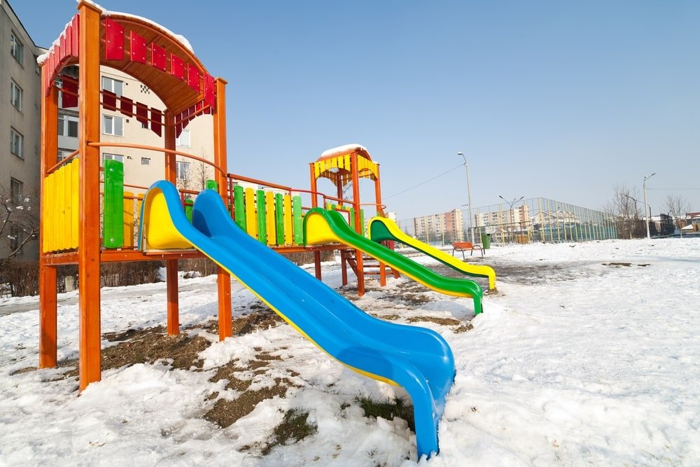 Play at a winter playground on a sunny day ~ Holiday Road Trip Tips for a Festive and Safe Journey