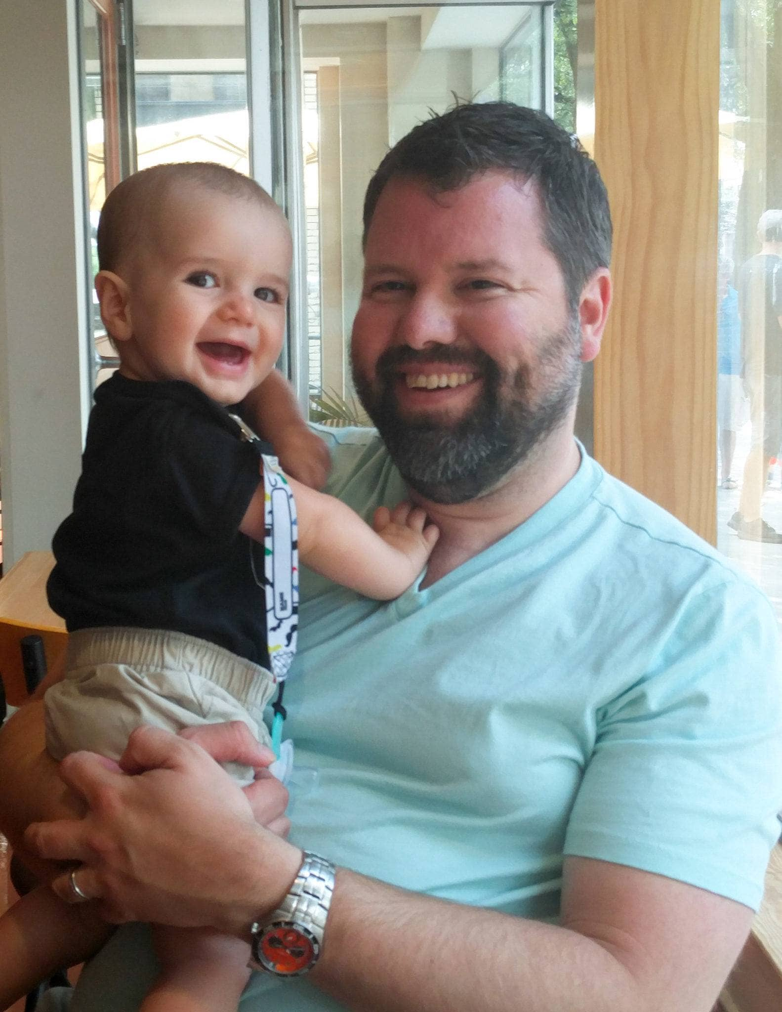 Daddy and baby chilling out at Newgrass Brewing ~ 10 Tips for Visiting a Brewery with Kids