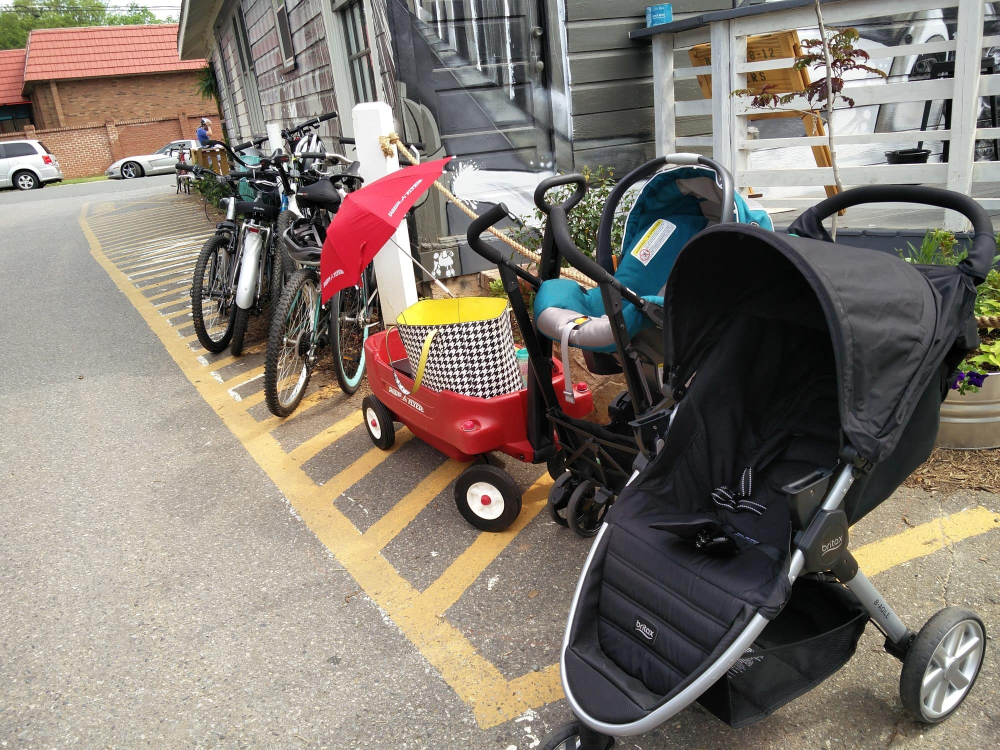 Strollers parked outside a brewery in Charlotte ~ 10 Tips for Visiting a Brewery with Kids