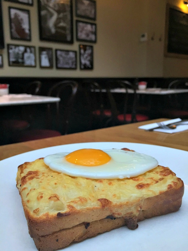 A croque madame is served with a fried egg on top ~ Best Grilled Cheese Sandwiches Around the World