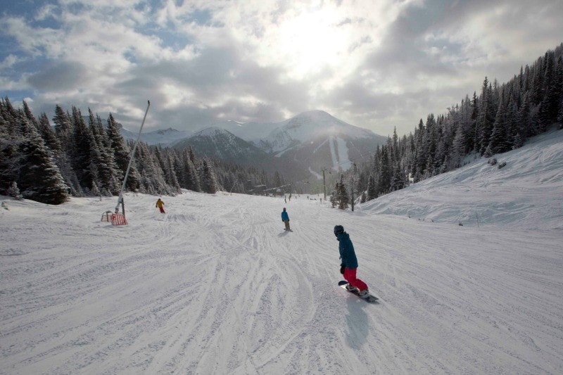 The Saucy Travel Mama boards down the back side of Lake Louise Ski Resort ~ Why Ski Lake Louise with Kids