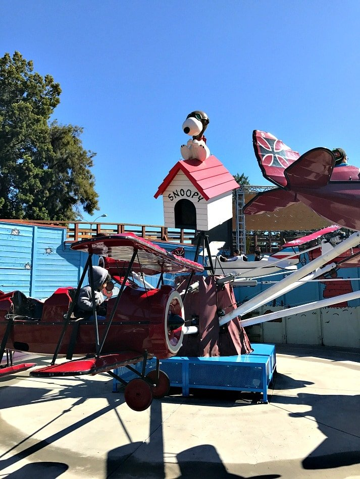Little kids will enjoy the 14 rides just for them in Camp Snoopy, including these Flying Ace airplanes ~ Disneyland vs Knott's Berry Farm