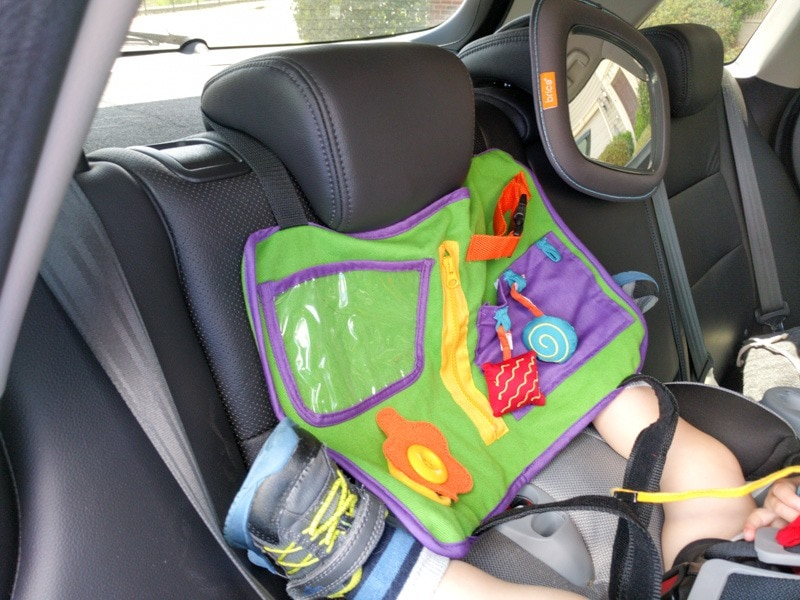Flip the Star Kids Play-N-Go Tray Table Cover and hang it from the head rest for more drive time fun