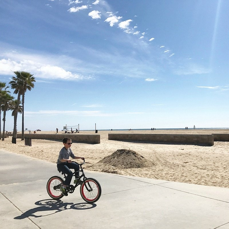 Rent bicycles to explore the beach boardwalk in Huntington Beach with kids