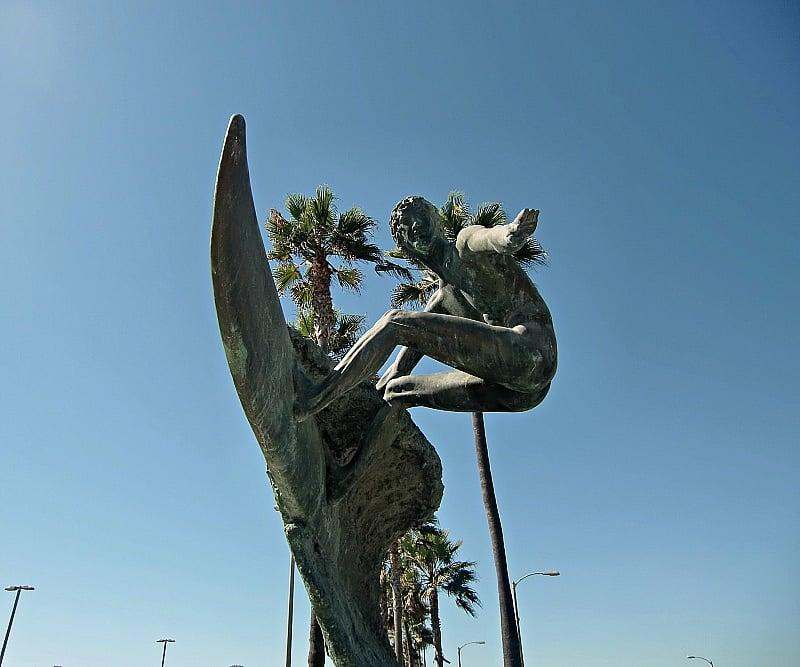A statue of Duke Kahanamoku, the Godfather of Surfing ~ Huntington Beach with Kids