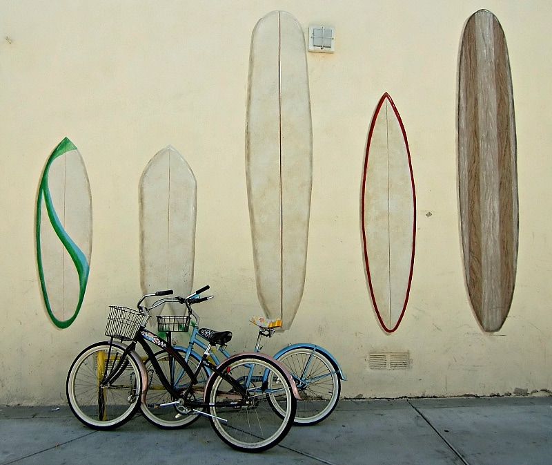 Beach cruisers in front of a surfboard mural in Huntington Beach, California ~ Huntington Beach with Kids, Surf City USA