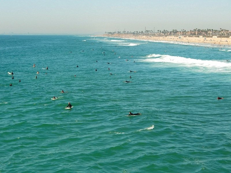 Surfers waiting to catch a wave in Huntington Beach, California ~ Huntington Beach with Kids