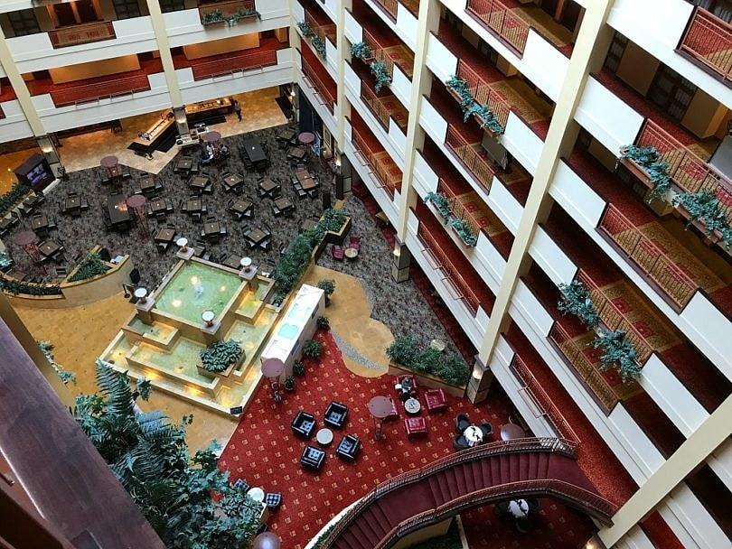 The hotel brand's signature courtyard and atrium at Embassy Suites Huntsville