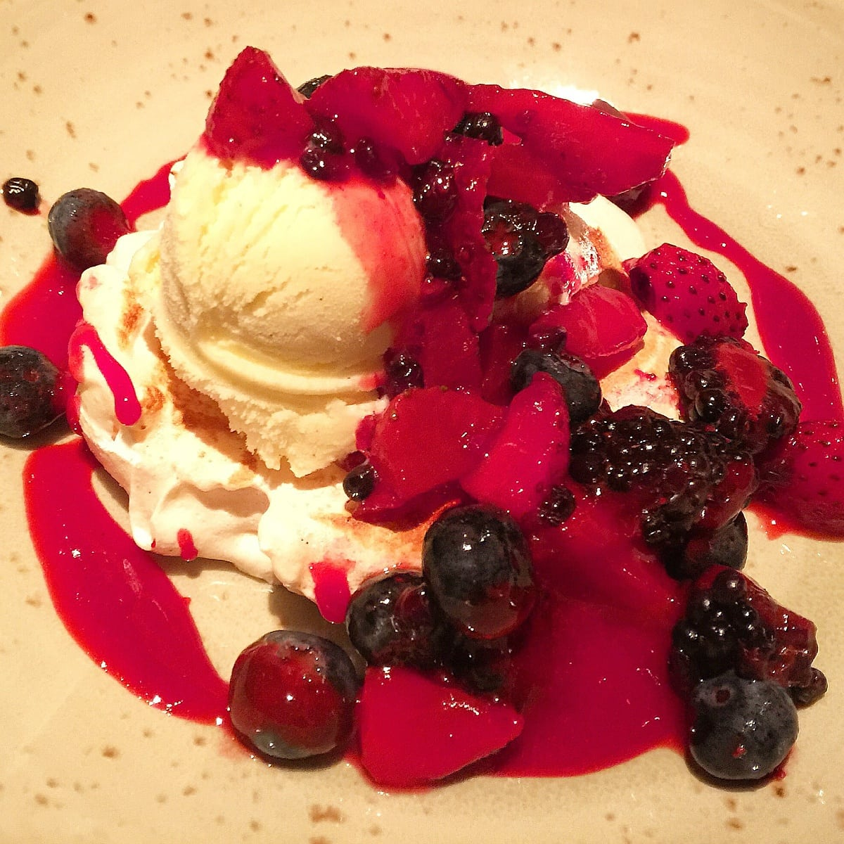 Pavlova topped with ice cream and fresh berries at Mountain Standard