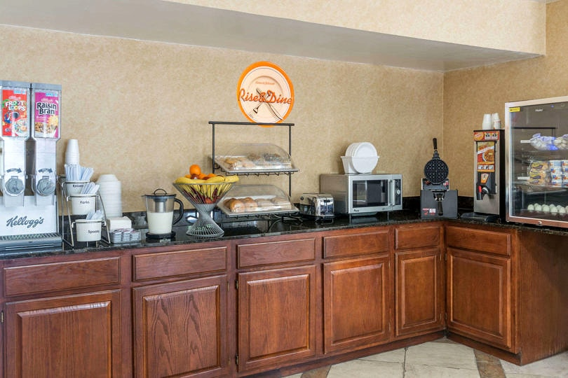 Free breakfast at Howard Johnson Hotels saves money AND time ~ 11 Tips to Save Money on Family Vacation this Summer