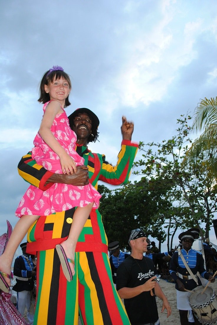 Scooped up by a stilt-walker in the Sesame Street Parade at Beaches Negril