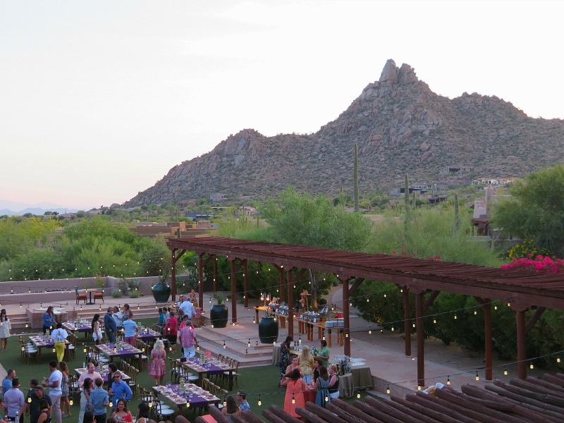 View of Pinnacle Peak in the distance and a wedding below from Onyx Bar & Lounge at Four Seasons Scottsdale with kids