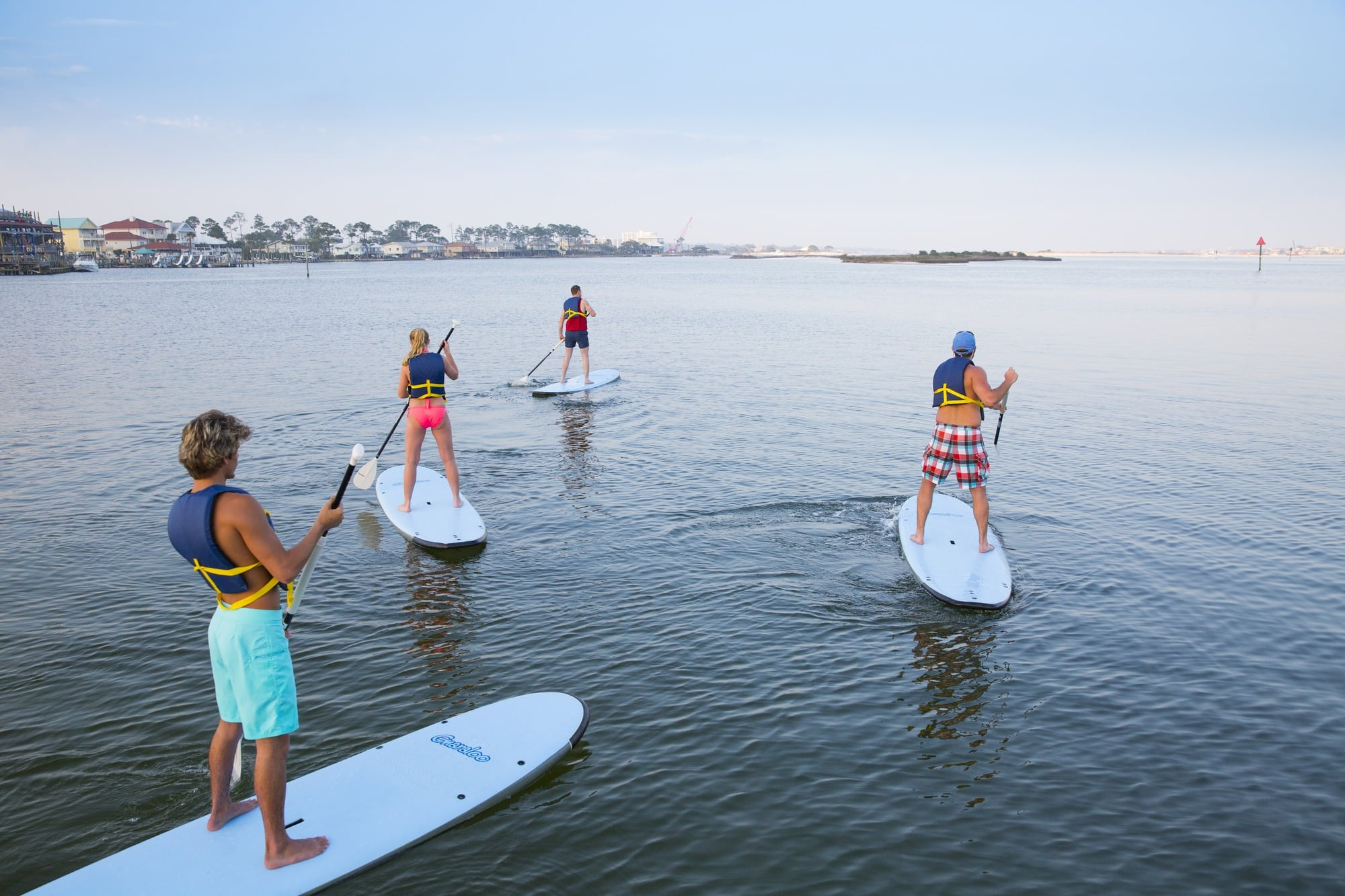 Stand up paddle boarding is a fun way to explore Gulf Shores with kids (