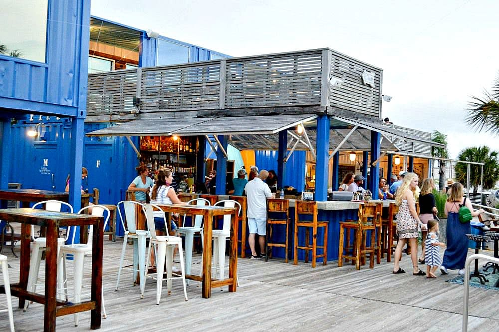 Dining al fresco among the shipping containers at The Gulf in Gulf Shores with kids