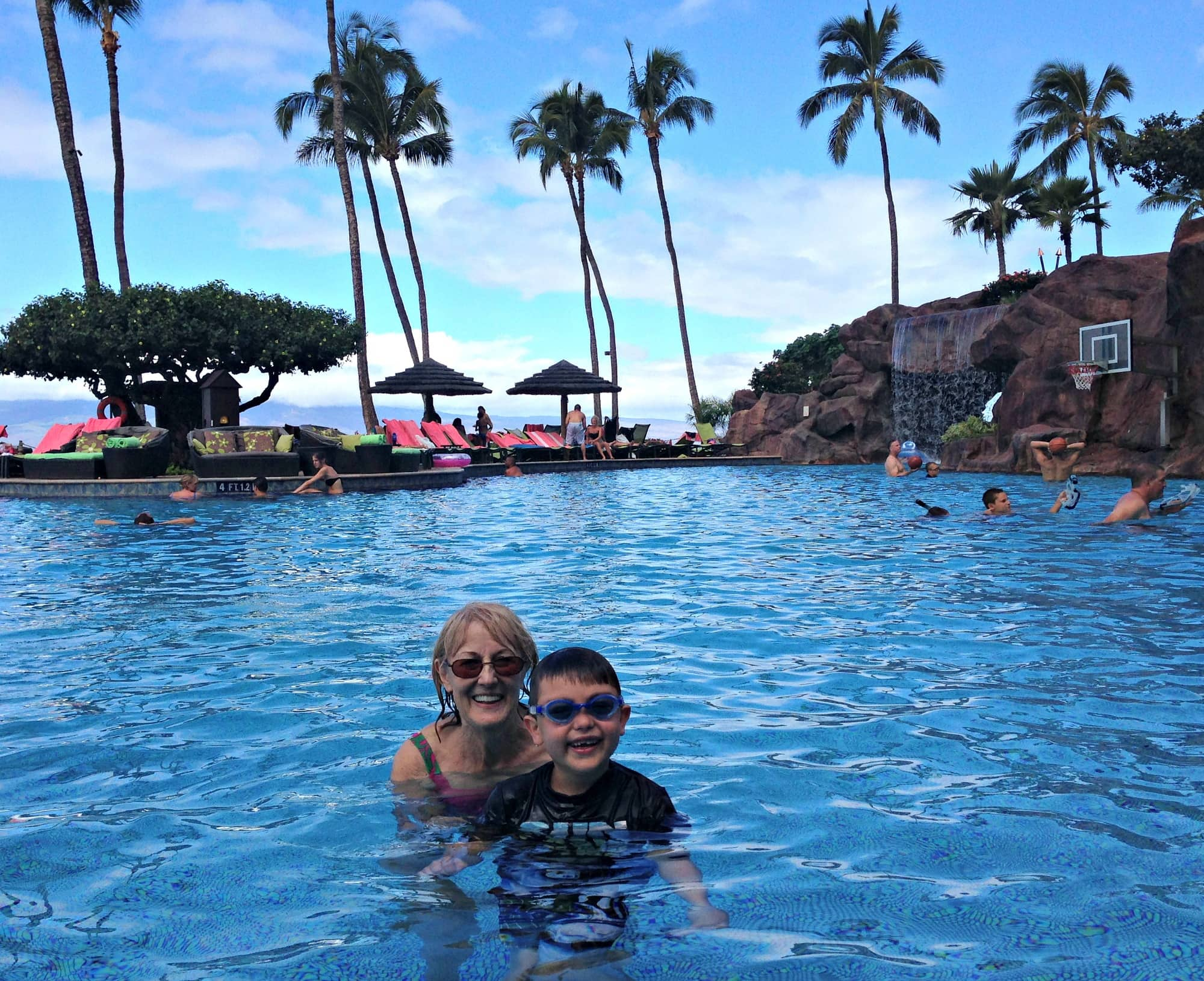 "My mom and son playing in the pool - you can see the water basketball ""court"" in the background at Hyatt Regency Maui with kids"