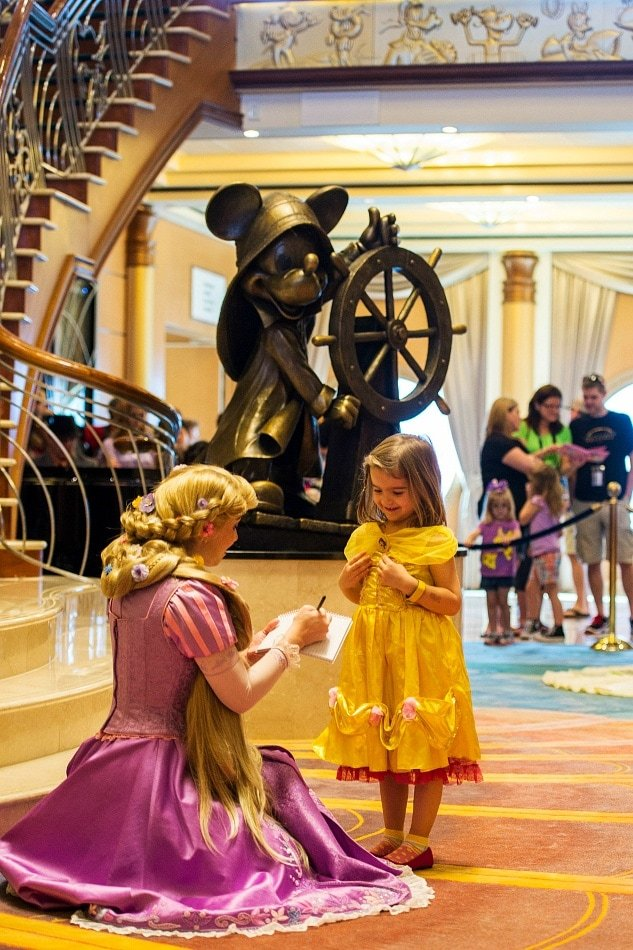 An autograph book makes meeting characters on a Disney Cruise even more fun ~ 13 Lucky Things to Pack for a Disney Cruise