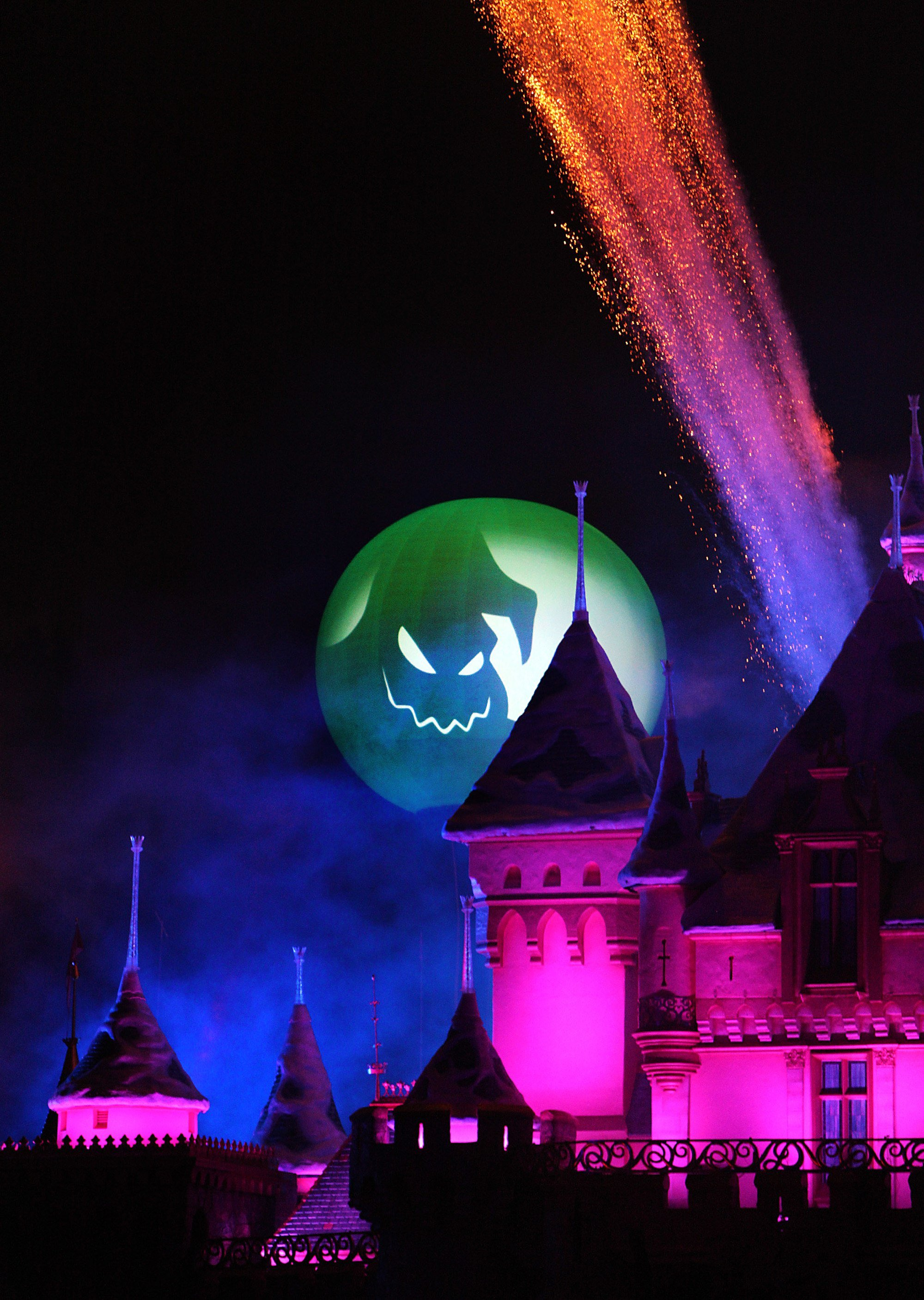 Halloween Screams-A Villainous Surprise in the Skies fireworks spectacular above Cinderella's Castle all lit up for Halloween at Mickey's Halloween Party with Kids