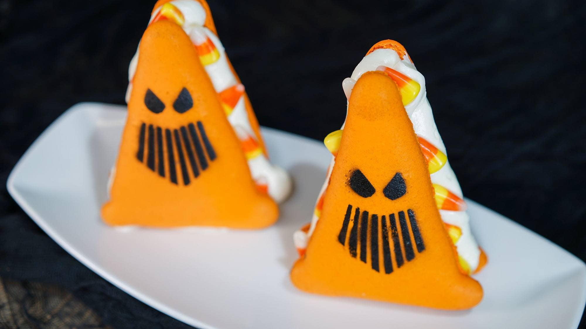 Spoke-y Cone Macaron filled with marshmallow buttercream and candy corn at the Cozy Cone Motel in Disney California Adventure during Mickey's Halloween Party with kids