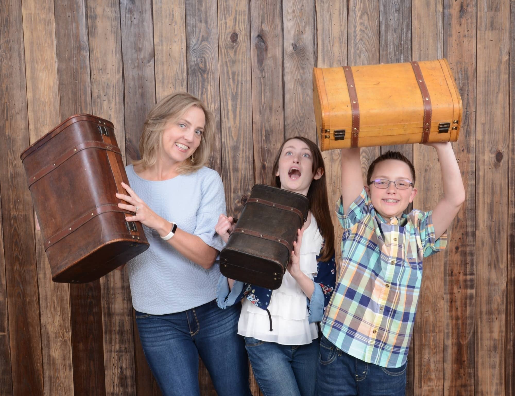 As The Travel Mama, I just had to get a shot with the suitcase props at Portrait Studio