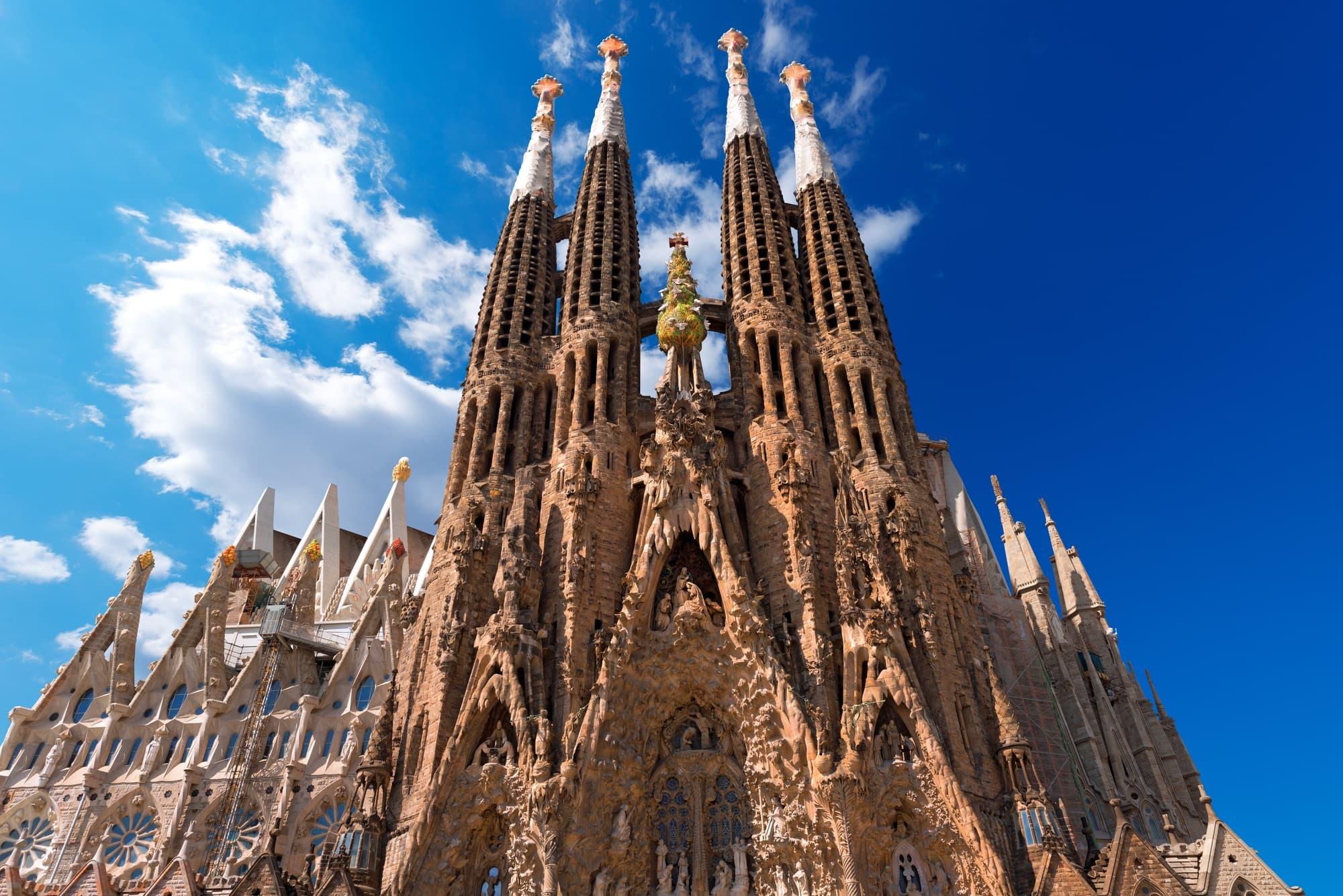 The famous Catholic basilica of the Sagrada Familia in Barcelona with kids