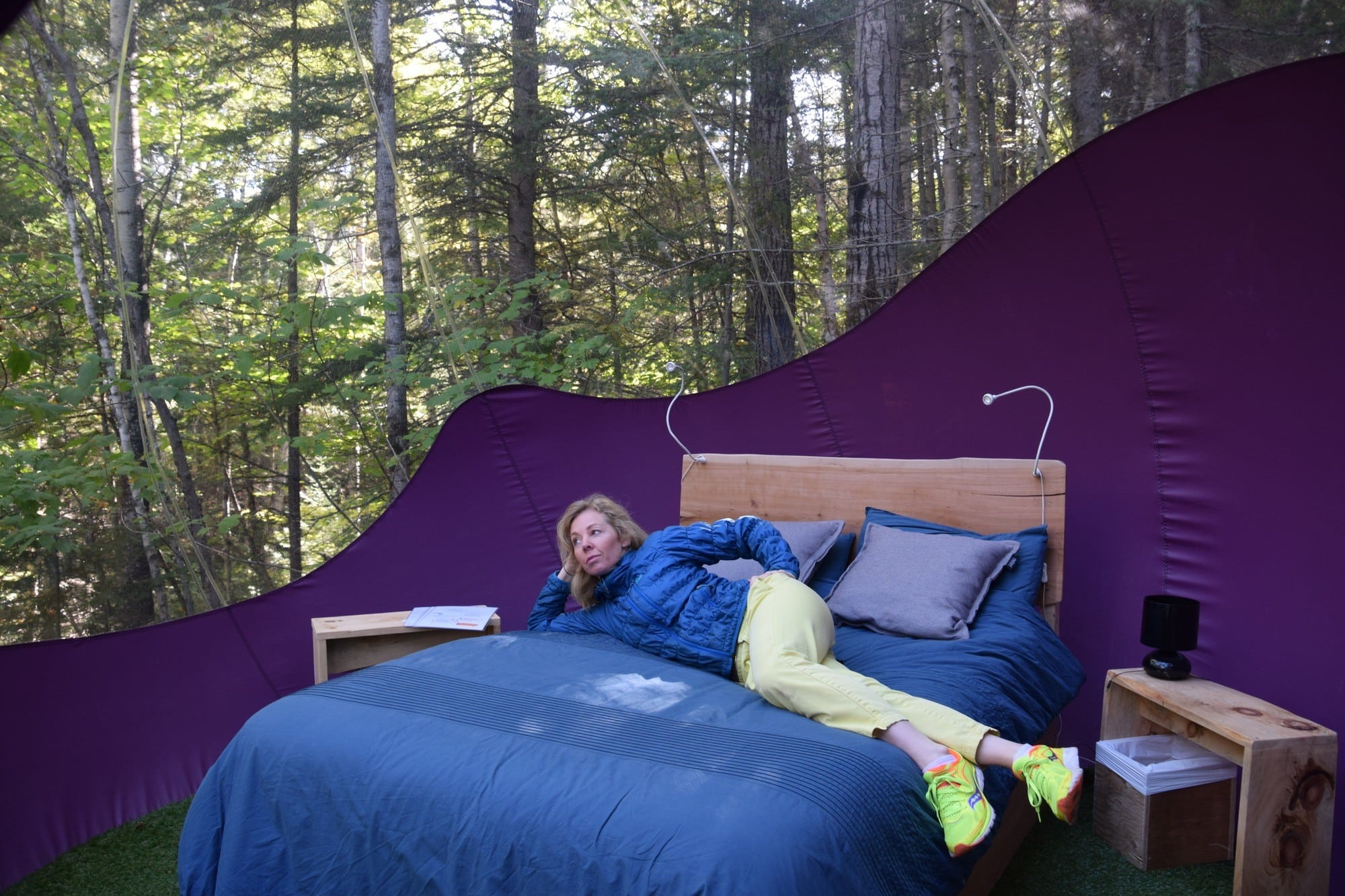 Jody Robbins getting cozy at Canopée Lit in Sacré-Coeur, Quebec while researching 25 Places in Canada Every Family Should Visit