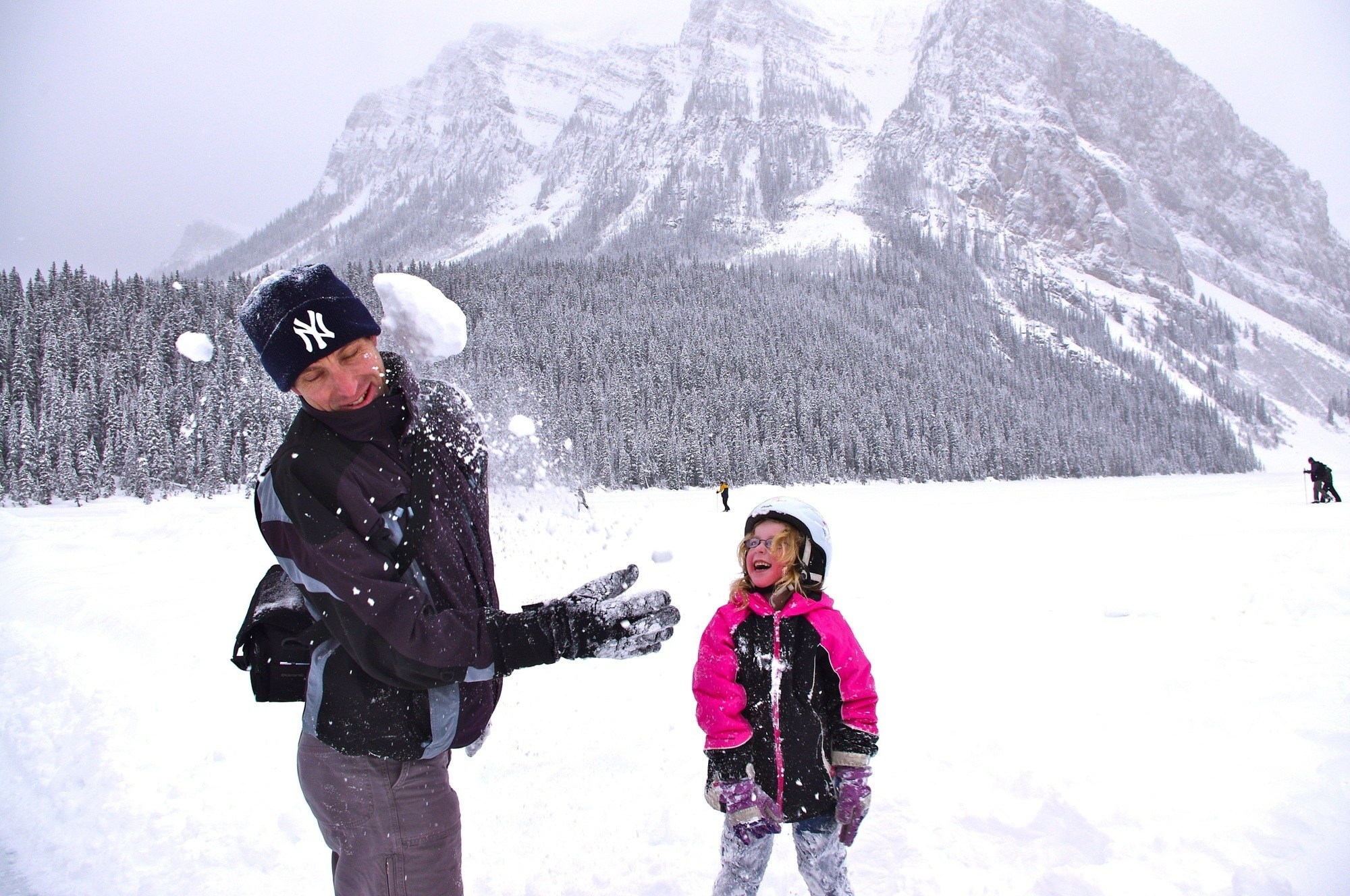 Family snowball fight at Lake Louise, Alberta ~ 25 Places in Canada Every Family Should Visit