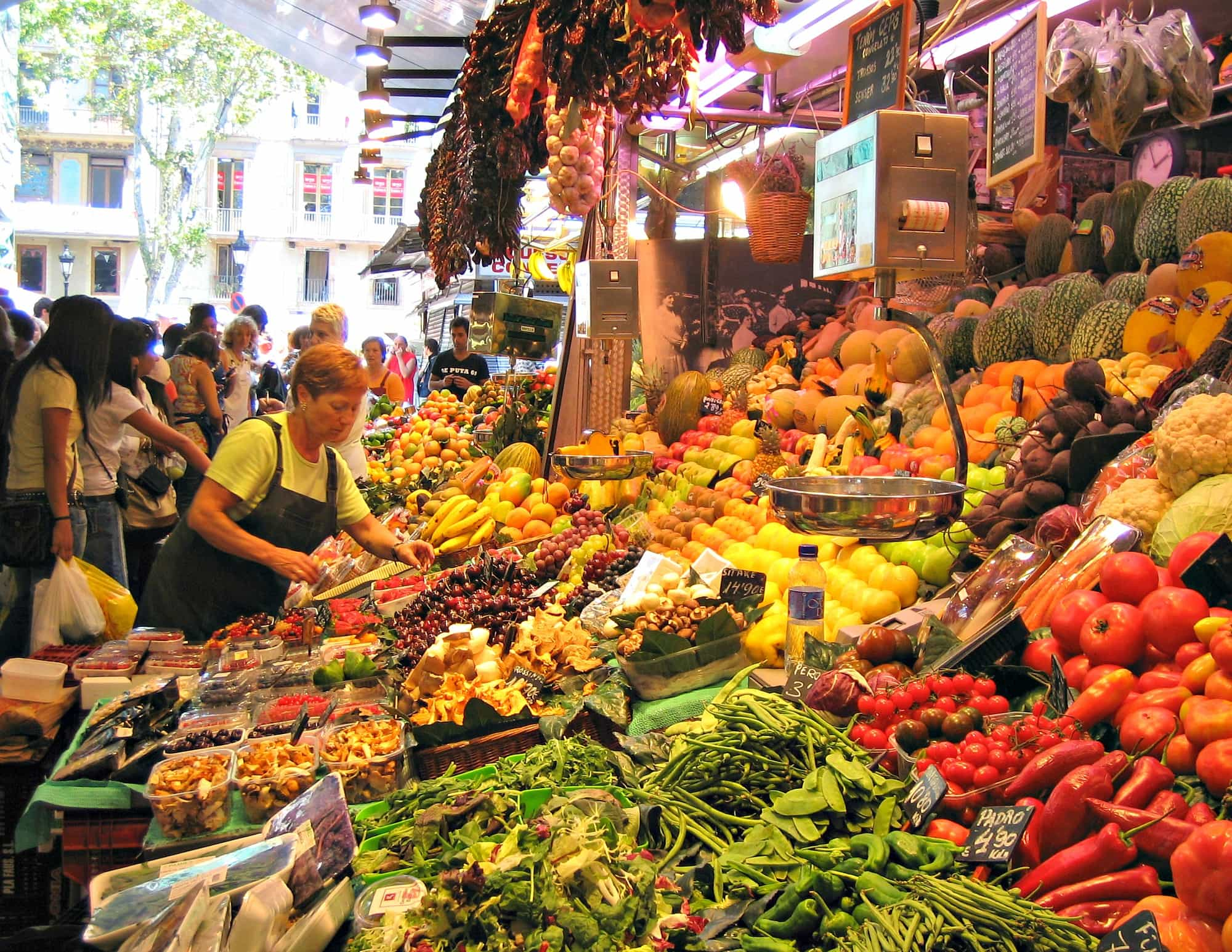 La Boqueria food market along La Rambla in Barcelona with kids