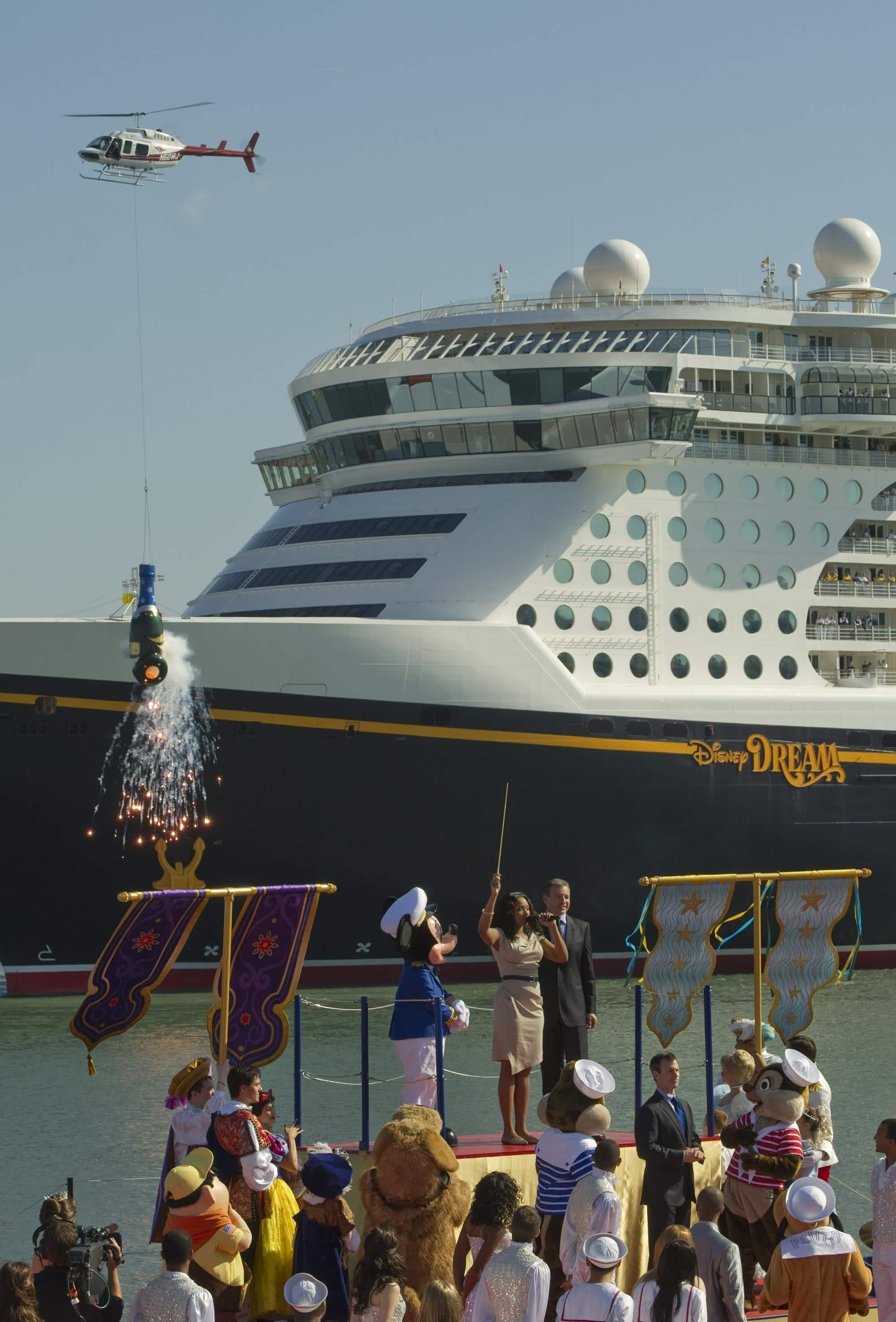 "Helicopter toting a gigantic Champagne bottle ""filled with dreams"" at Disney Dream christening ceremony"