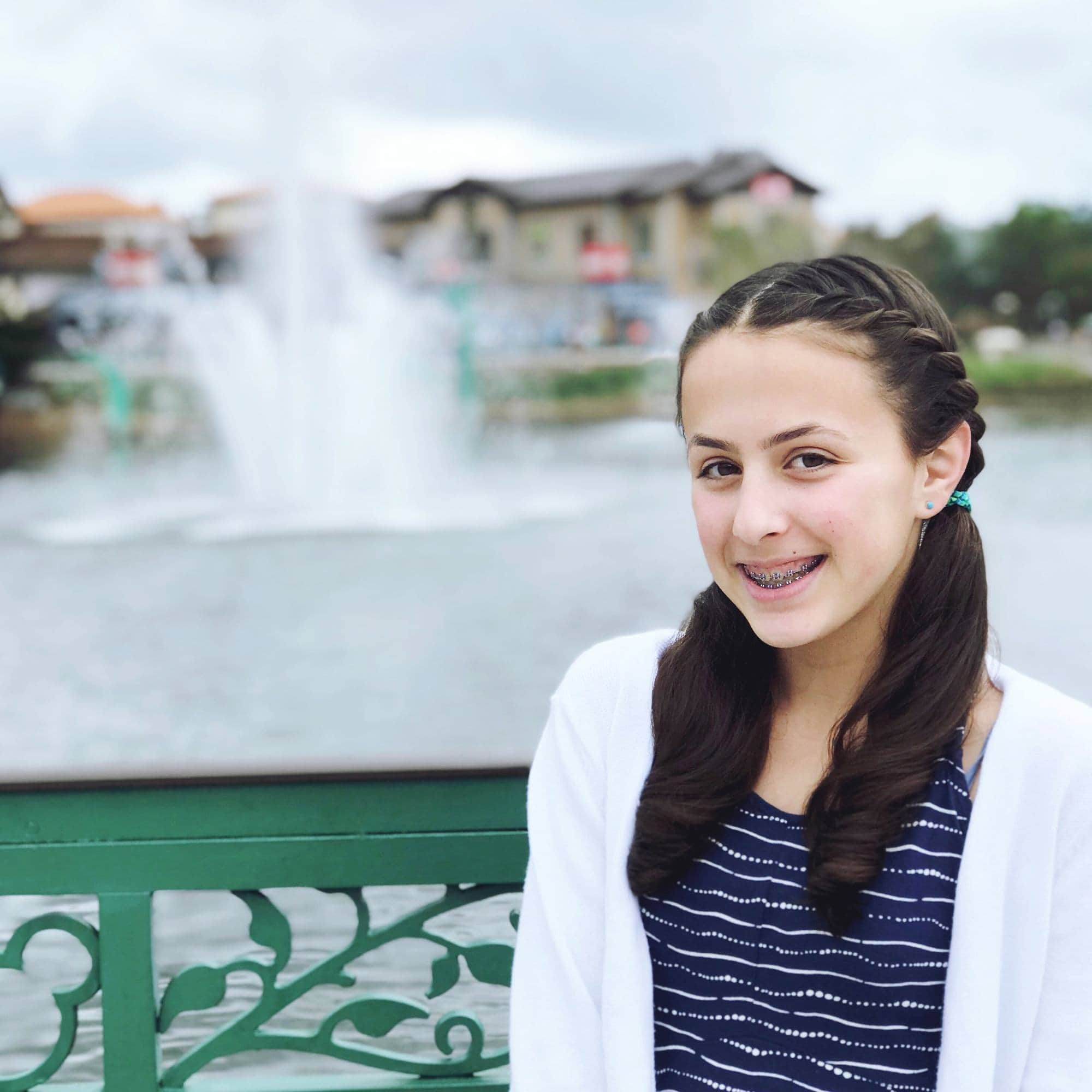A tween posing at Disney Springs ~ Disney World with Teens & Tweens
