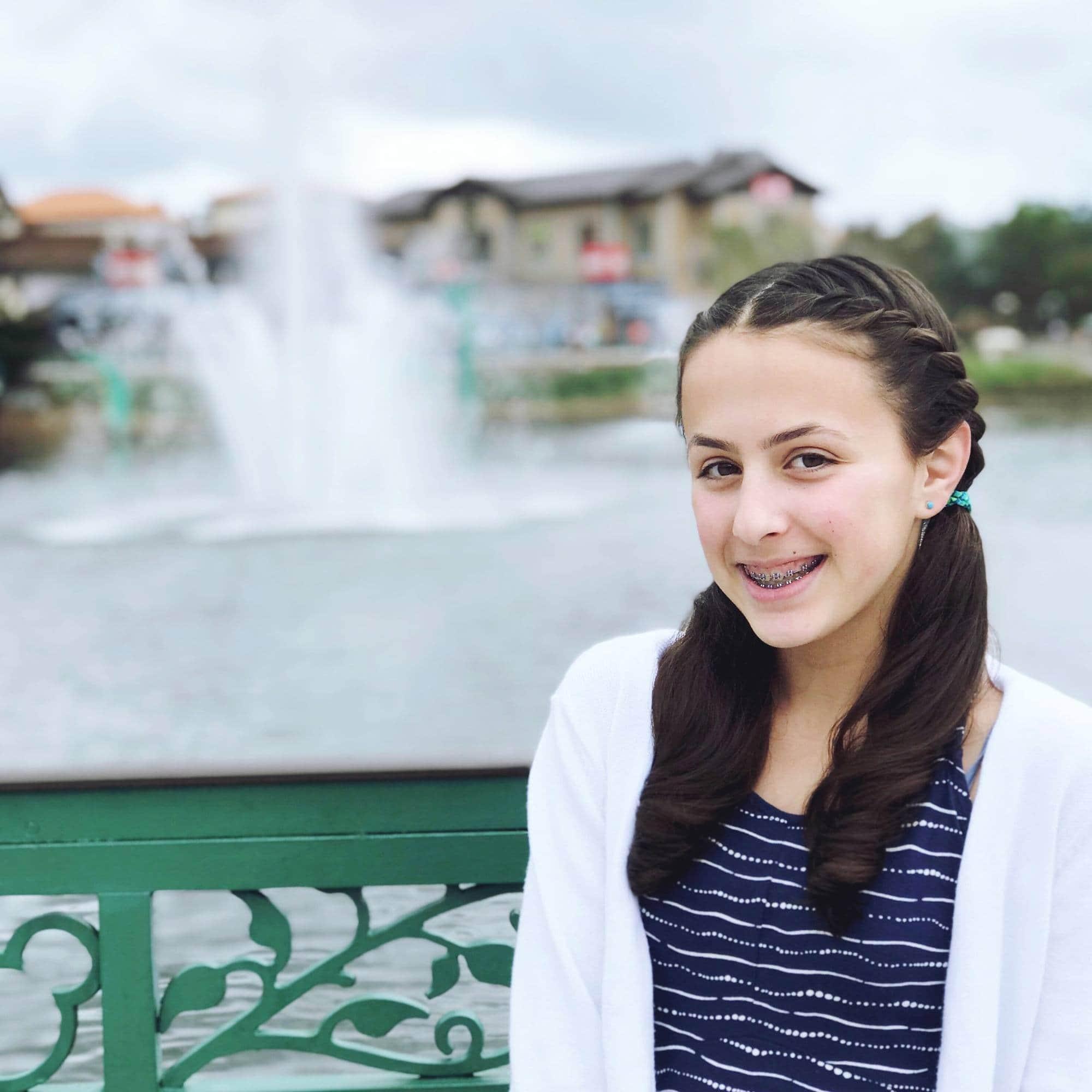 A tween posing at Disney Springs ~ Disney World with Teens & Tweens