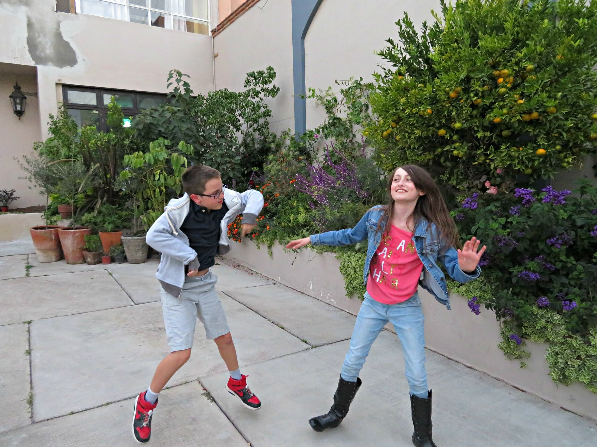 My kids doing a happy dance outside our San Miguel de Allende vacation rental