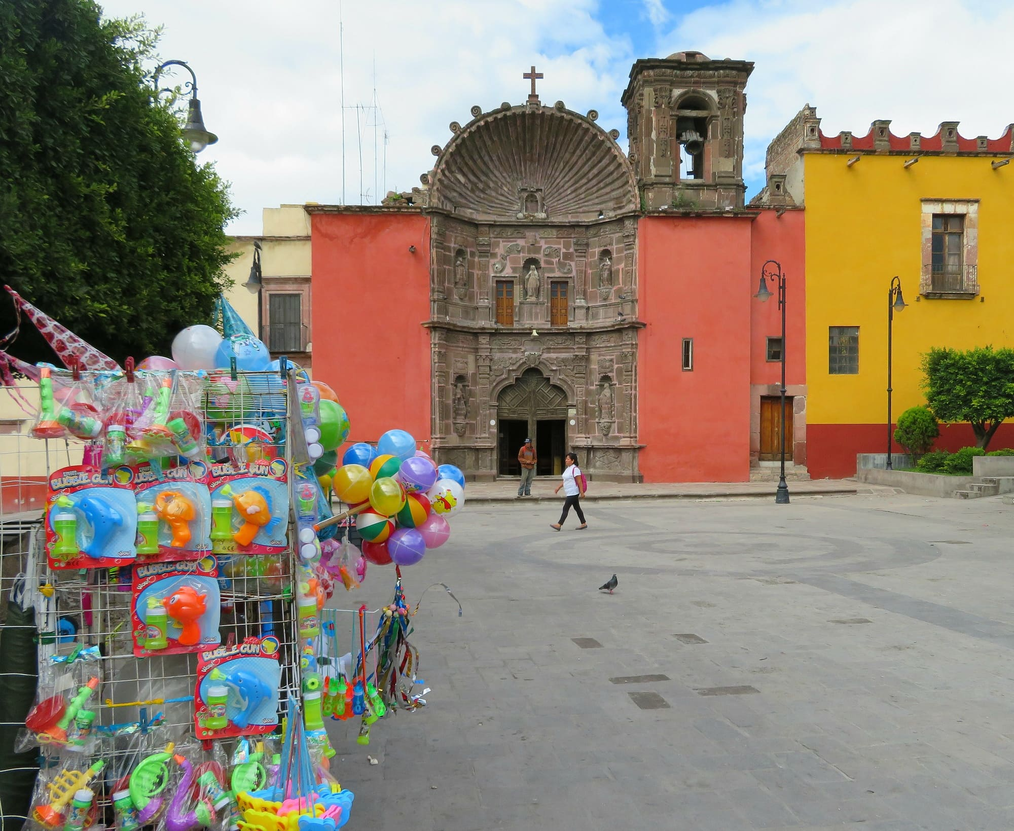Toys for sale at Plaza de la Soledad in San Miguel de Allende with kids