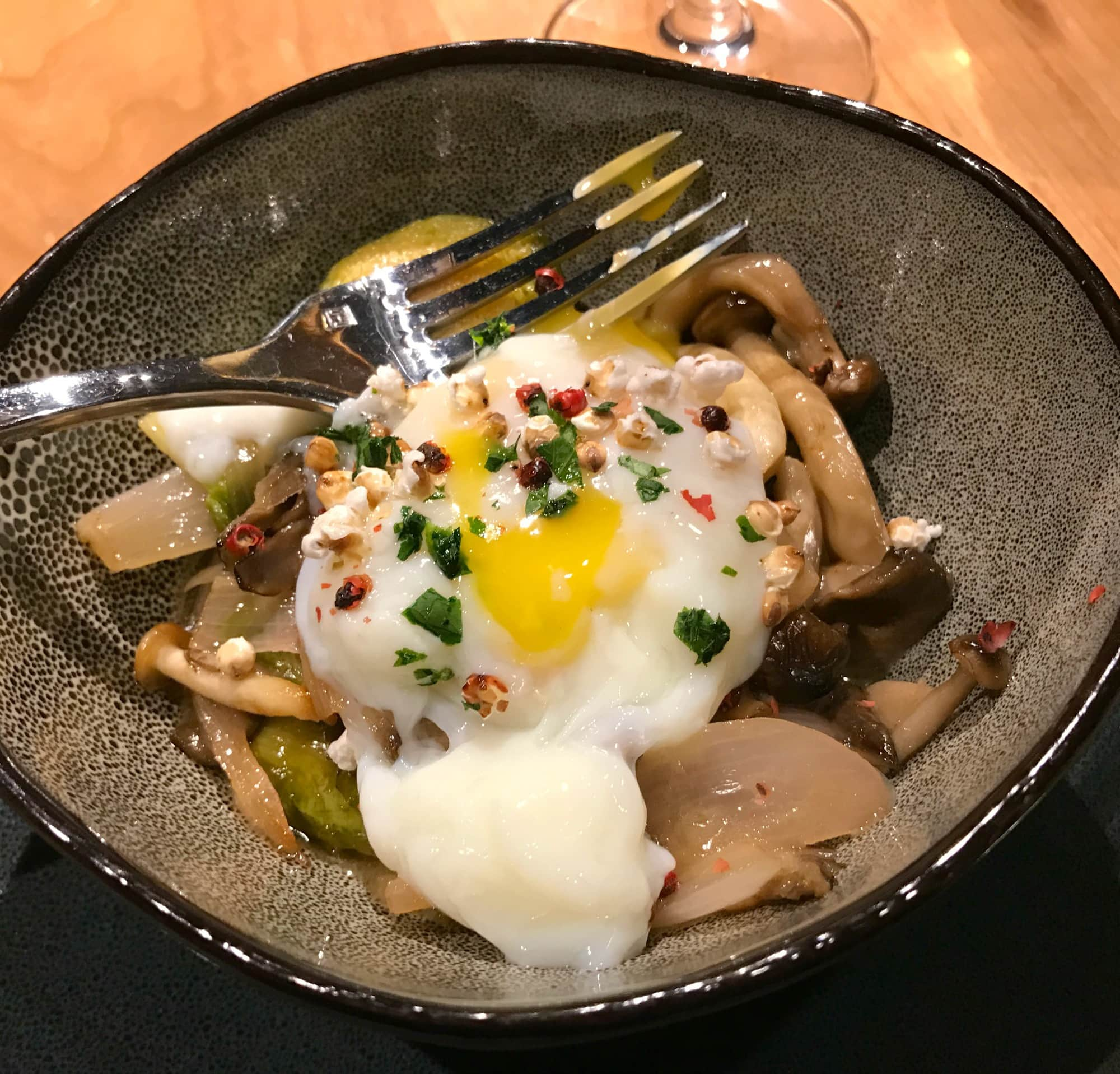 "My Organic Farm Egg starter at Manzanita served with wild mushroom ragout, Brussels sprout, sorghum ""popcorn"" and truffle"
