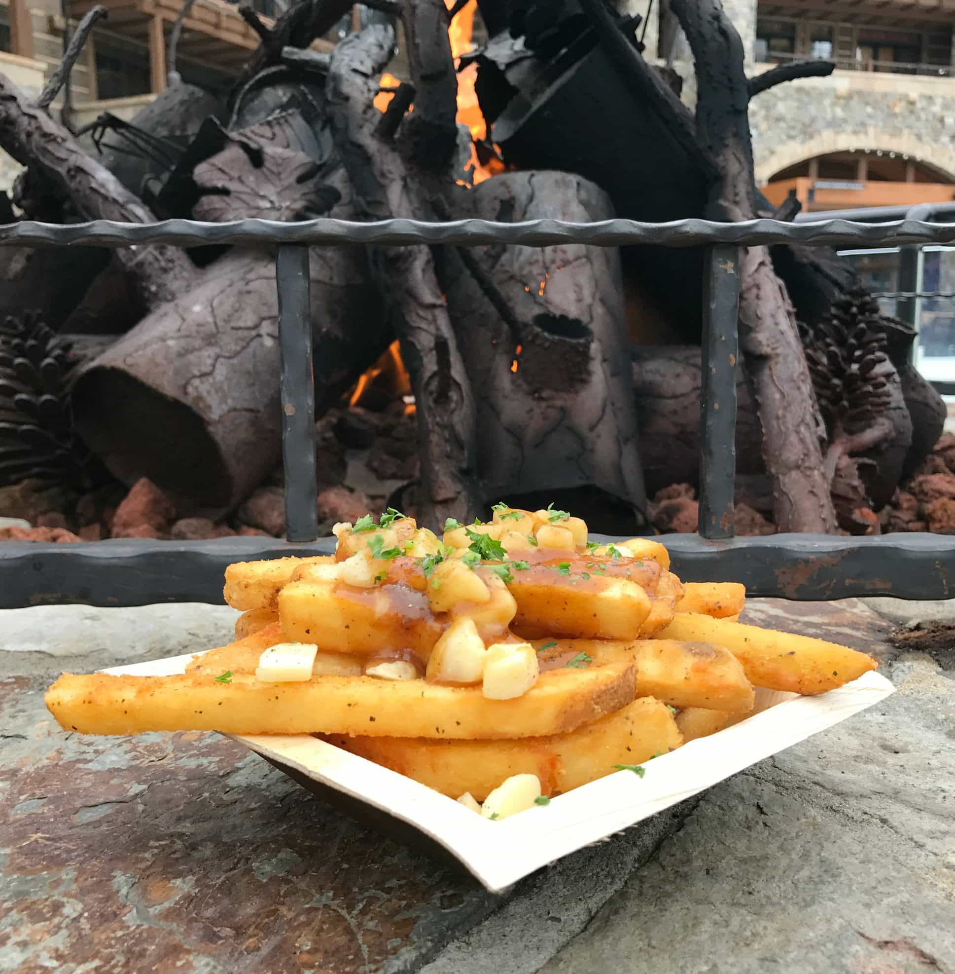 Poutine makes a tasty apres ski treat from the Frites stand in the Village at Northstar with kids