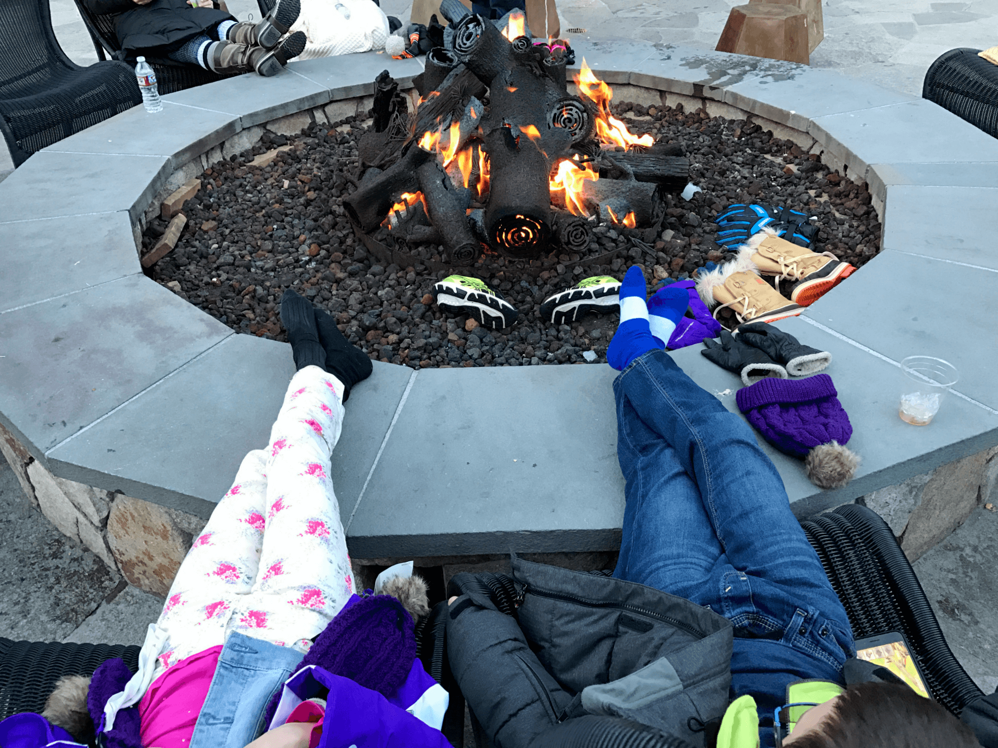 Warming up by the fire at Marshmology at Northstar California with kids