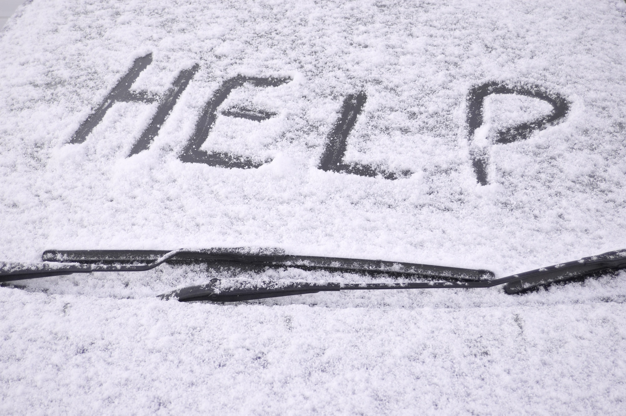 A help sign and brightly covered cloth used as a flag will let other drivers know you are in distress ~ 5 tips to prepare your vehicle for a winter road trip