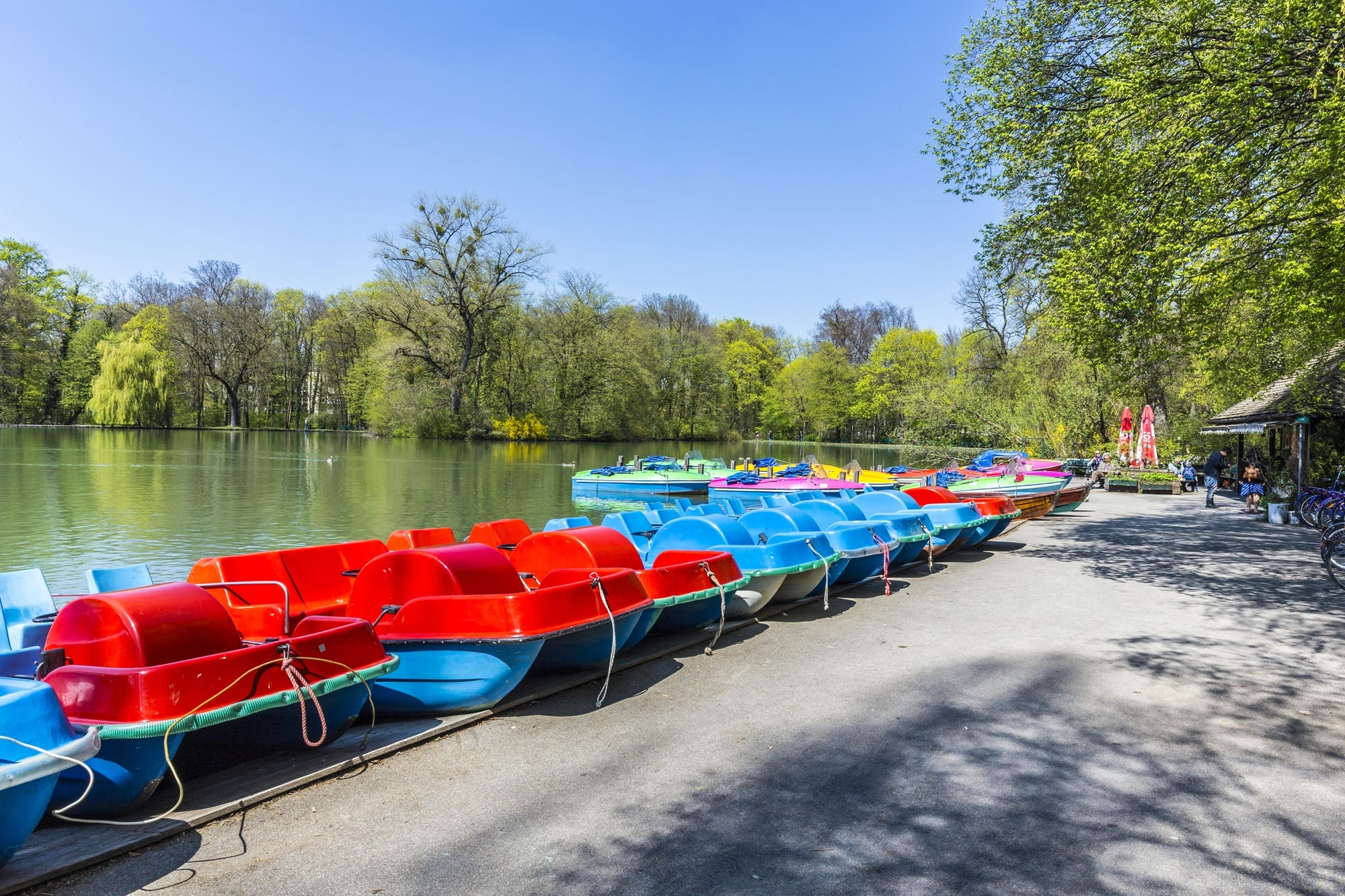 Boats for rent at Kleinhesseloher Lake in the English Garden in Munich with kids