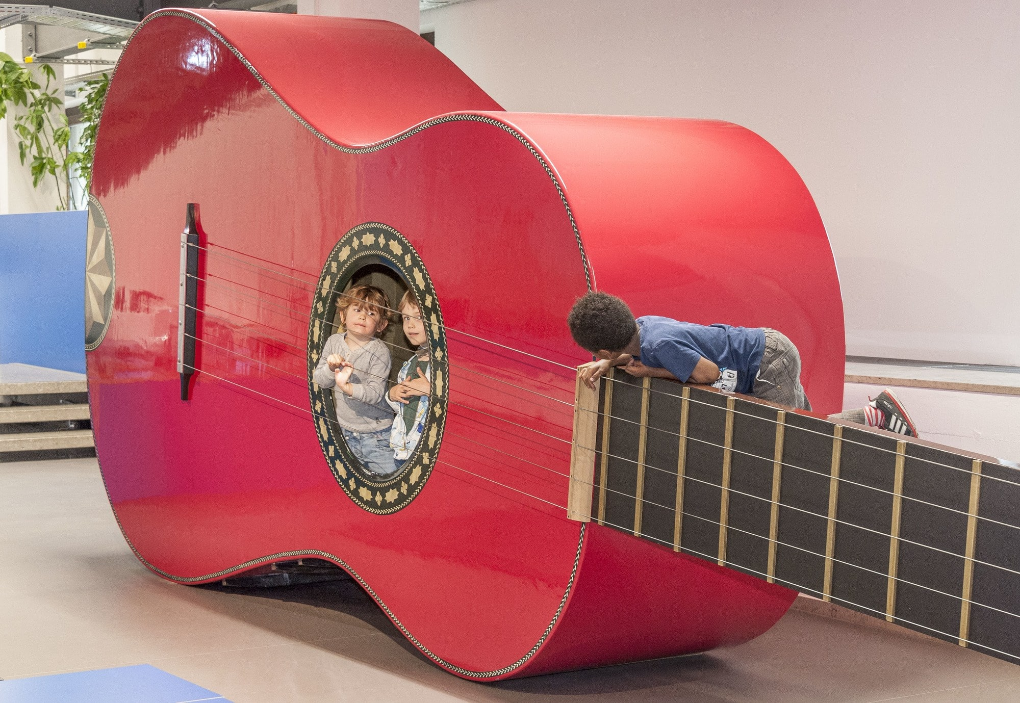 Inside a giant guitar at the Deutsches Museum, kids can find out how it feels when someone plucks the strings ~ Munich with kids
