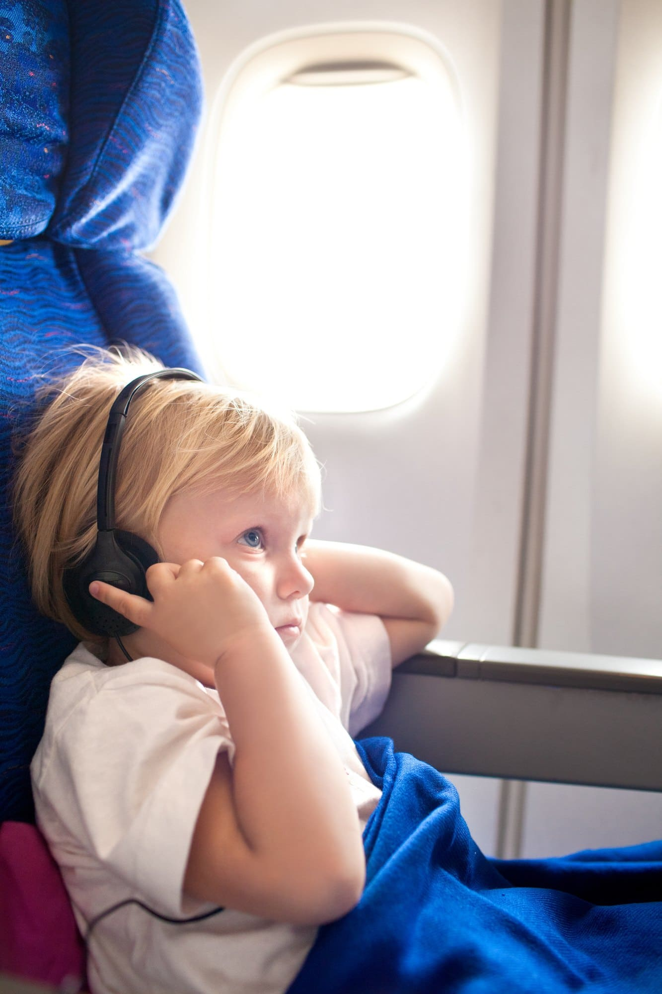 Listening to music or an audiobook can distract children from the feeling of motion sickness while traveling