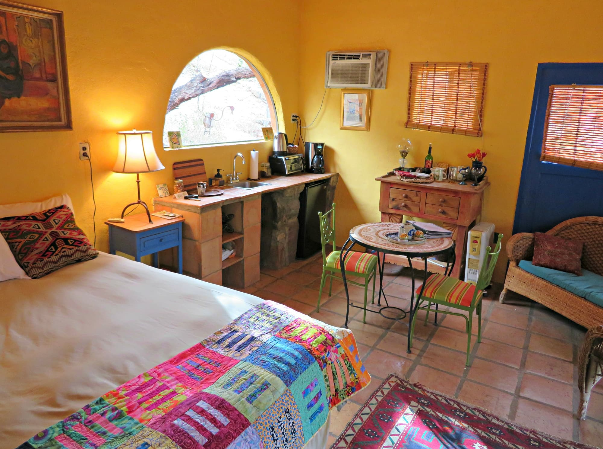 The Blue Door Casita offers a queen-sized bed, mini kitchenette and bathroom at Aravaipa Farms for a romantic retreat
