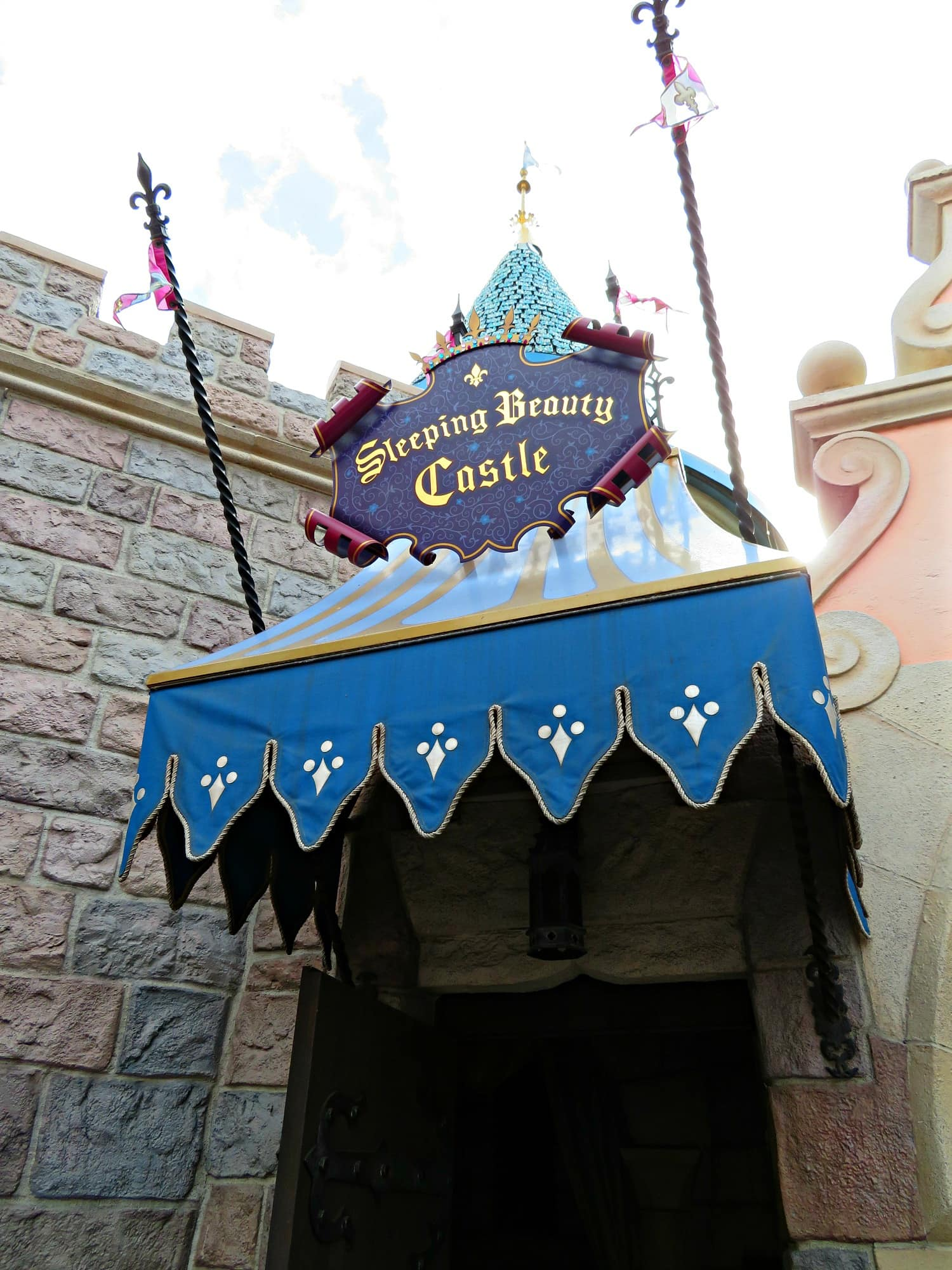Read the story of Sleeping Beauty inside her castle ~ Educational Things to Do at Disneyland with Kids