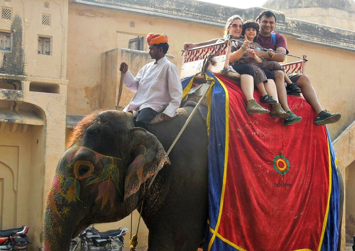 Riding an elephant outside Amber Fort in Jaipur, India with kids